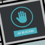 Ad blocked with blue hand up symbol
